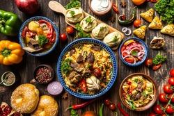 Uzbek and Central Asia cuisine concept. Assorted Uzbek food pilaf samsa lagman manti shurpa Uzbek restaurant concept Uzbek food. Food recipe background