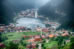 Uzungol(Long Lake): One of the most beautiful tourist places in Turkey. The mountain valley with a trout lake and a small village in Trabzon,Turkey. Popular summer destination for tourists.
