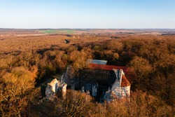 Vértesszentkereszt, Hungary - Aerial view about former benedictine monastery and church ruins. Hiding in the woods between Oroszlány and Pusztavám. Romanesque age architecture.