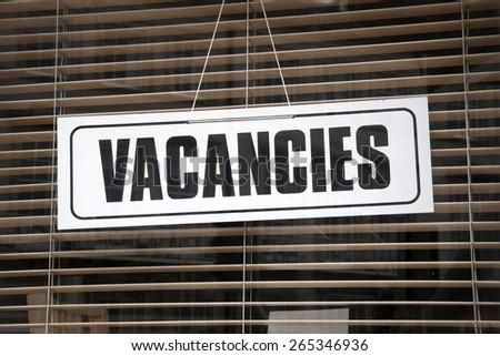 Vacancies Sign on Hotel Window