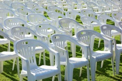 Vacant empty plastic white chairs pattern