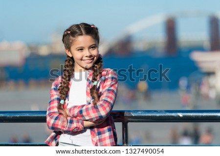 Vacation and leisure. What do on holidays. Sunny day walk. Leisure options. Free time and leisure. Girl cute kid with braids relaxing urban background defocused. Organize activities for teenagers.