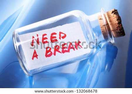 """Vacation and stress concept. Vintage bottle with text message """"need a break"""""""
