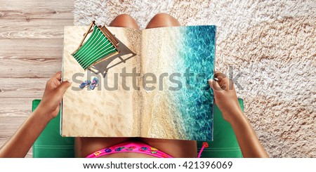 Vacation  and Travel. Top view. Young woman on the beach near the sea