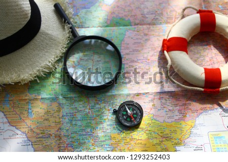 Vacation and Travel: Vacation and Travel around the world, the magnifying glass will help us find the country in the map,the compass will help with the direction. #1293252403