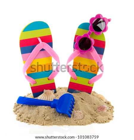 Vacation at the beach with flip flops and sunglasses