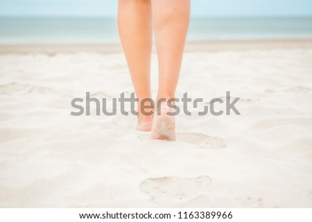 Vacation. Beach. Female feet on the sand. #1163389966