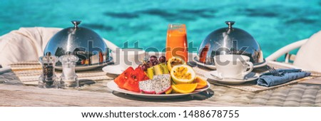 Vacation breakfast table at luxury restaurant or hotel room panoramic banner. Romantic cruise honeymoon travel holiday in Maldives or Tahiti. #1488678755