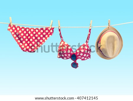 Vacation fashion concept. Summer woman clothes accessories stylish set. Summertime fashionable swimsuit bikini red polka dots, sunglasses. Concept creative Girl outfit. Minimal Foto stock ©