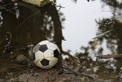Vacation Football Concept was left near the water source