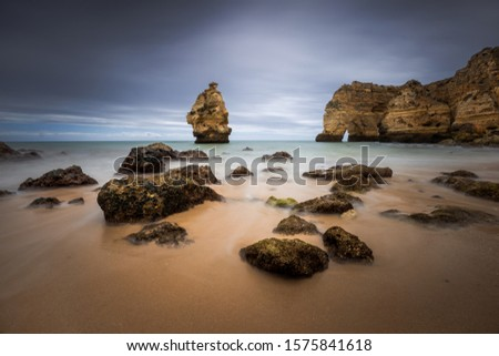 Vacation holidays background wallpaper, Tranquil scenery, relaxing beach. Beautiful coast of Algarve, Portugal.