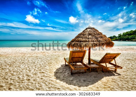 Vacation holidays background wallpaper - two beach lounge chairs under tent on beach. Sihanoukville, Cambodia #302683349