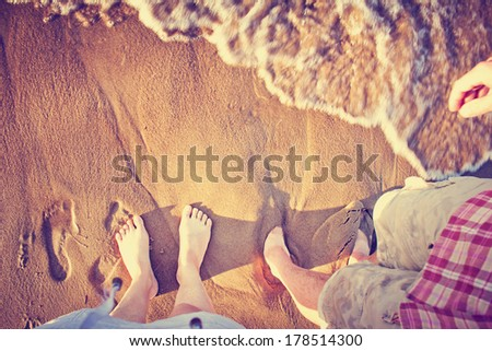 Vacation holidays.Feet closeup of relaxing on beach in sunny summer day