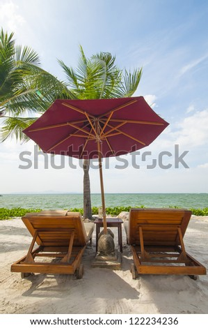 Vacation Image Of Beach Umbrella And Loungers On Tropical Beach