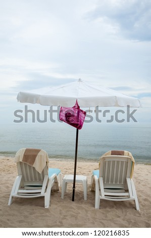 Vacation Image Of  Beach Umbrella And Loungers On Tropical Beach With Copy Space