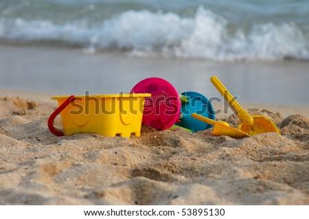 Vacation image of children's beach toys on the sand