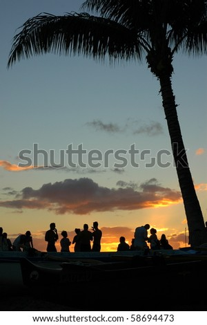 Vacation Image of Young People at a Beach Party During a Beautiful Summer Sunset