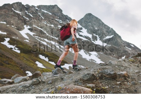 Vacation in mountains woman hiking alone adventure trail healthy lifestyle outdoor summer activity trekking in Norway endurance training motivation concept