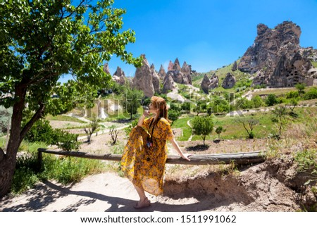 Vacation in Turkey view of Uchisar Castle Village during summer with tourist model #1511991062