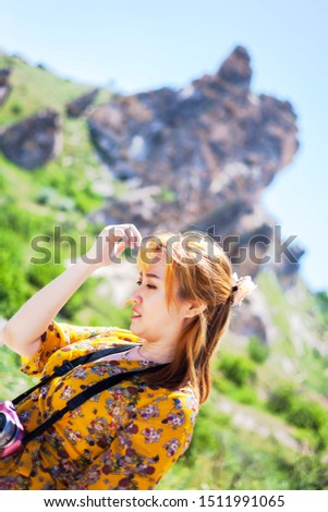 Vacation in Turkey view of Uchisar Castle Village during summer with tourist model #1511991065