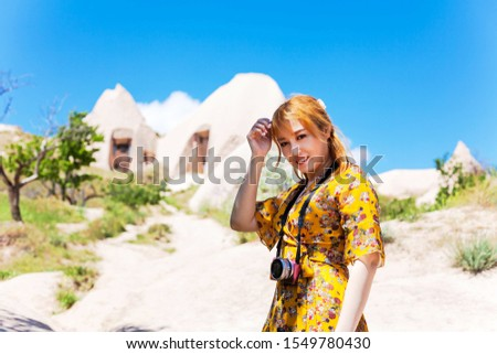 Vacation in Turkey view of Uchisar Castle Village during summer with tourist model #1549780430