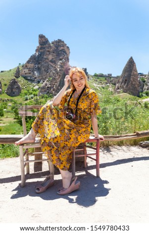 Vacation in Turkey view of Uchisar Castle Village during summer with tourist model #1549780433