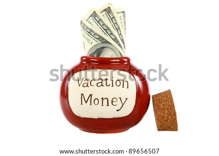 vacation money jar jam packed with cash isolated on white with room for your text