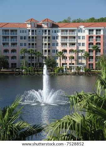 Vacation Resort Buildings Fountain and Blue Lake