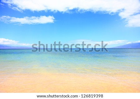 Vacation summer beach ocean background texture. Blue water, sky, sand and beach. Travel, vacation and summer holiday concept image from Maui, hawaii.