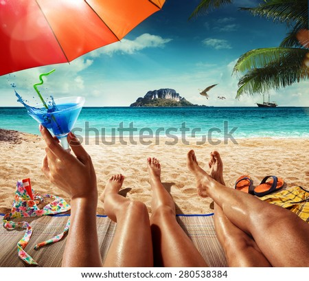 Vacation. Summer travel. Man and woman on the tropical beach. Close view