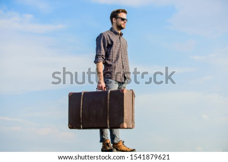 Vacation time. Travel agency. Business trip. Handsome guy traveler. Guy outdoors with vintage suitcase. Luggage concept. Travel with luggage. Travel blogger. Man carrying his things in baggage.