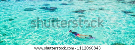 Vacation tourist snorkel woman swimming snorkeling in paradise clear water banner panorama. Swim girl snorkeler in crystalline waters and coral reefs. Turquoise ocean background. #1112060843