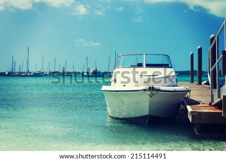 vacation, travel and sea concept - white boat at blue sea #215114491