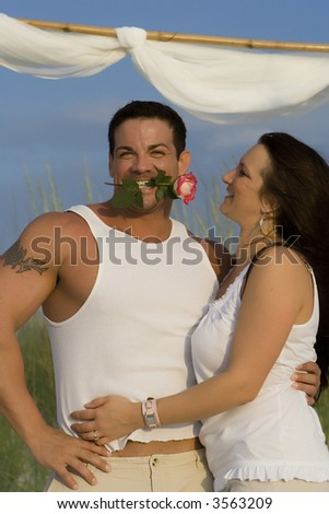 Vacationing happy couple having fun on a beach. - stock photo