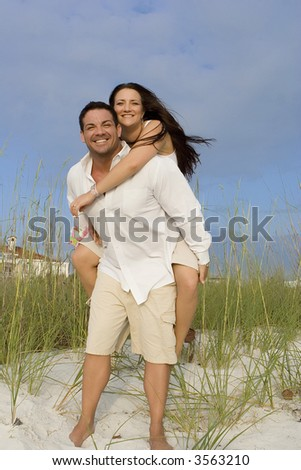 Vacationing happy couple having fun on a beach.