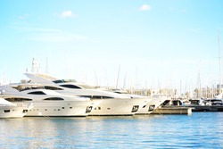 Vacations And Tourism Concept, Beautiful white modern yachts at sea port Alicante, Spain