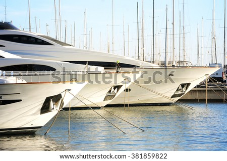 Vacations And Tourism Concept, Beautiful white modern yachts at sea port Alicante, Spain stock photo