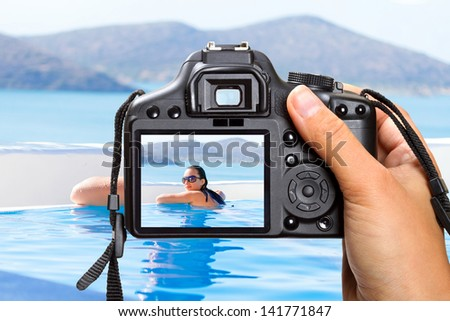 Vacations at swimming pool in Greece with the camera
