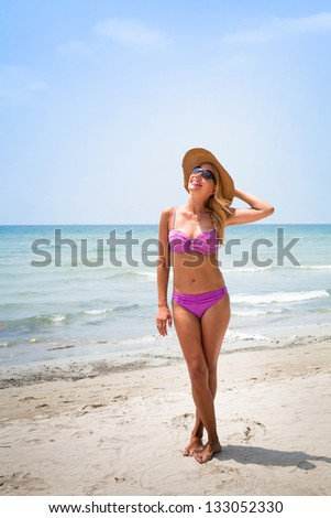 vacations on the beach, portrait of blond sexy woman