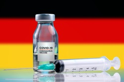 Vaccine and syringe injection. It use for prevention, immunization and treatment from corona virus infection (novel coronavirus disease 2019, Covid-19). Germany Flag background.