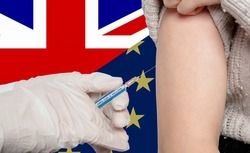 Vaccine distribution between UK and Europe symbolic with divided flags and a vaccination