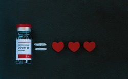 Vaccine, equal symbol and three red hearts on black background. Coronavirus vaccine for the treatment and prevention of the disease Covid-19 saves lives and gives hope to mankind. Medical concept.