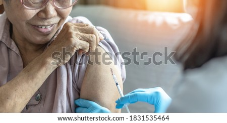 Vaccine shot for elderly vaccination, medical immunization for aging senior woman, older patient, geriatric treatment from disease such as coronavirus, covid-19, Influenza, pneumococcal or hepatitis B Stock photo ©