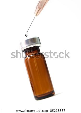 Vaccine vials with syringe
