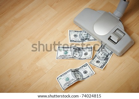 vacuum cleaner and money on the floor