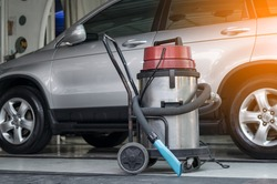 vacuum cleaner at carcare or auto washing service station with sunlight effect