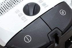 vacuum cleaner control buttons. Close-up details. House cleaning or home appliance repair concept