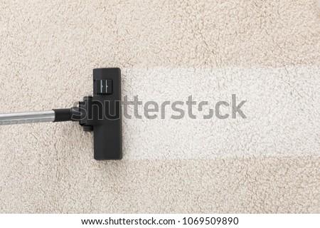 Vacuum cleaner on carpet