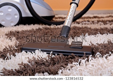 vacuum cleaner on fluffy carpet