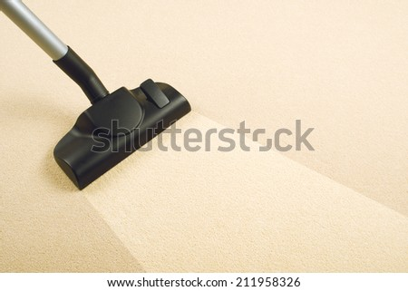 Vacuum Cleaner sweeping Brand New Carpet. Housework and home hygiene.